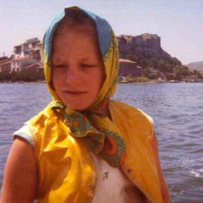 Young Polly in scarf sailing in front of Bages